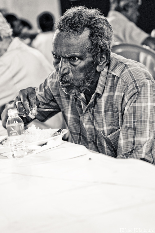 Man at Lunch (D700, Tamron 24-135mm f/3.5-5.6 @ 135mm, f5.6 , ISO 1000, 1/60sec)