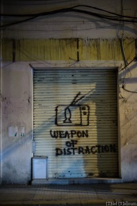 Weapon of (Mass) Distraction (D700, Nikkor 50mm f2.8 @ 50mm, f1.4, ISO 1000, 1/60sec)